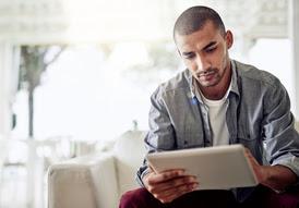 Man looking at computer tablet