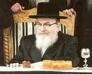 Skvere Rebbe on chair