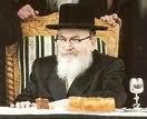 Skvere Rebbe on chair