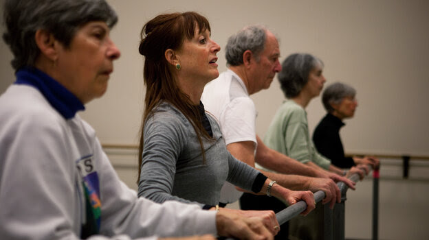 """Dance teacher Lucy Bowen McCauley (second from left) finds that simply humming can help her students with Parkinson's get their feet to """"unfreeze"""" and match the song's rhythm."""