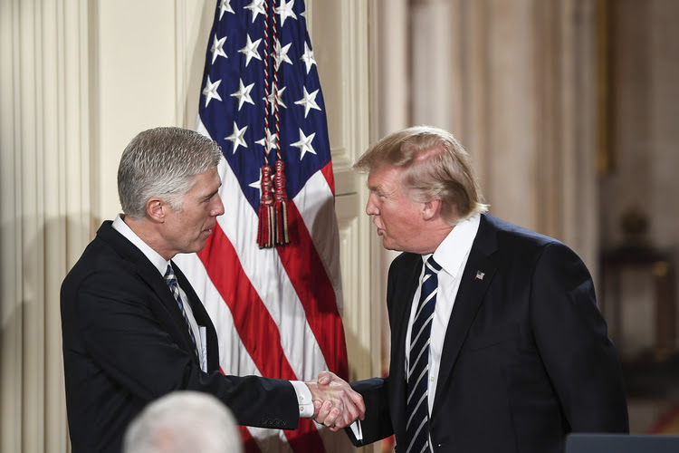 President Trump introduces Neil Gorsuch in the East Room at the White House last night. (Photo by Jabin Botsford/The Washington Post)</p>