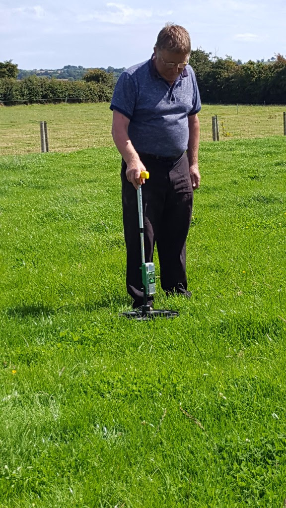 Christopher White from  Naul North Co. Dublin using a plate meter to measure grass