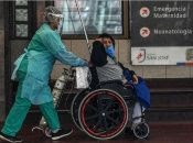 A health worker transports a COVID-19 patient at San Jose Hospital in Santiago, Chile, May 20, 2020.