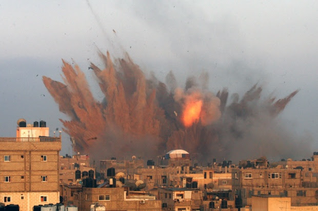 A ball of fire is seen following an Israeli air strike in Rafah, in the southern of Gaza Strip.