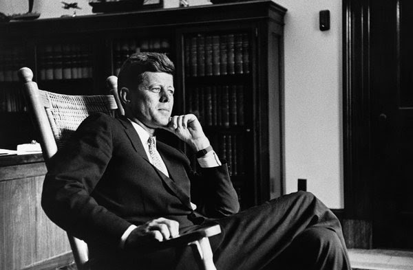 President John F. Kennedy in his famed Oval Office rocking chair.