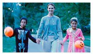 A parent with two dressed up kids for Halloween, takes you to a Kids.gov Hallowween safety page.