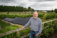 Garry Charnock near some of the many solar panels in Ashton Hayes, England. Mr. Charnock, a former journalist, started the town's emissions-reduction effort about 10 years ago.