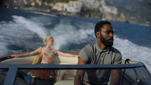 Elizabeth Debicki and John David Washington star in director Christopher Nolan's latest time-warping film, Tenet.