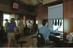 Vets review X-rays in the repository at Keeneland
