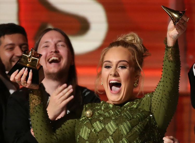 "Adele breaks the Grammy for Record of the Year for ""Hello."" (Reuters/Lucy Nicholson)</p>"