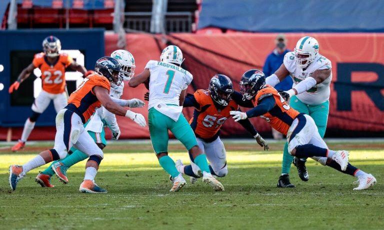 Tua Tagovailoa swarmed by Broncos defenders
