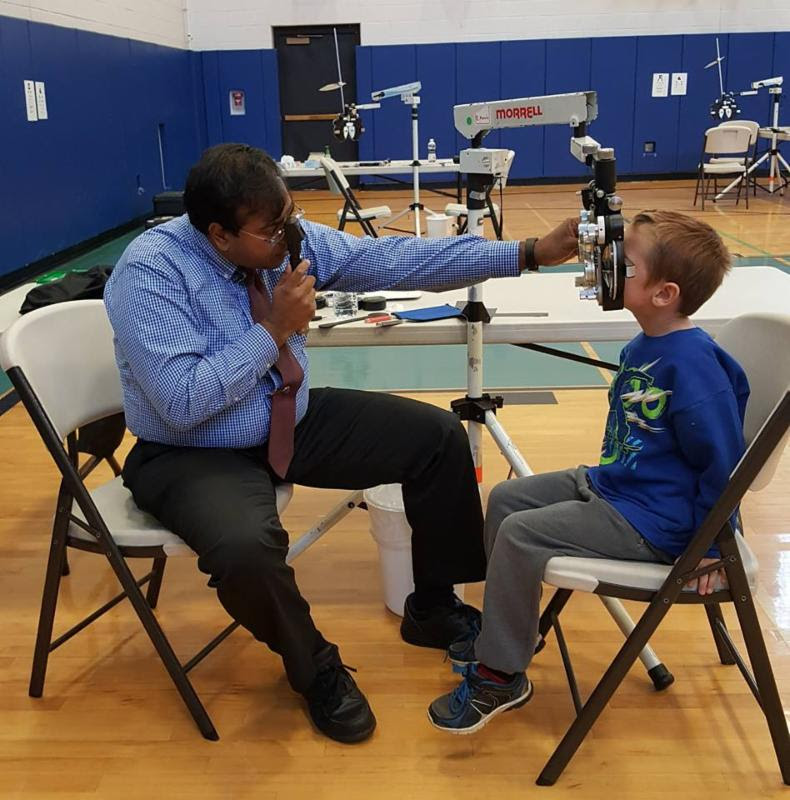 optometrist examines child in Fort Edward