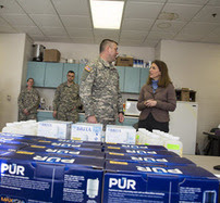 Secretary Burwell and National Guard member in Flint