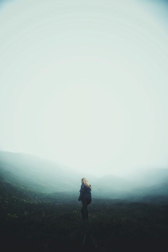 woman walking into fog