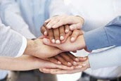 Photo of stacked hands representating partnership