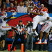 Alabama's ArDarius Stewart leaping for a 32-yard touchdown catch during the third quarter Saturday while in the clutches of Florida's Vernon Hargreaves III.