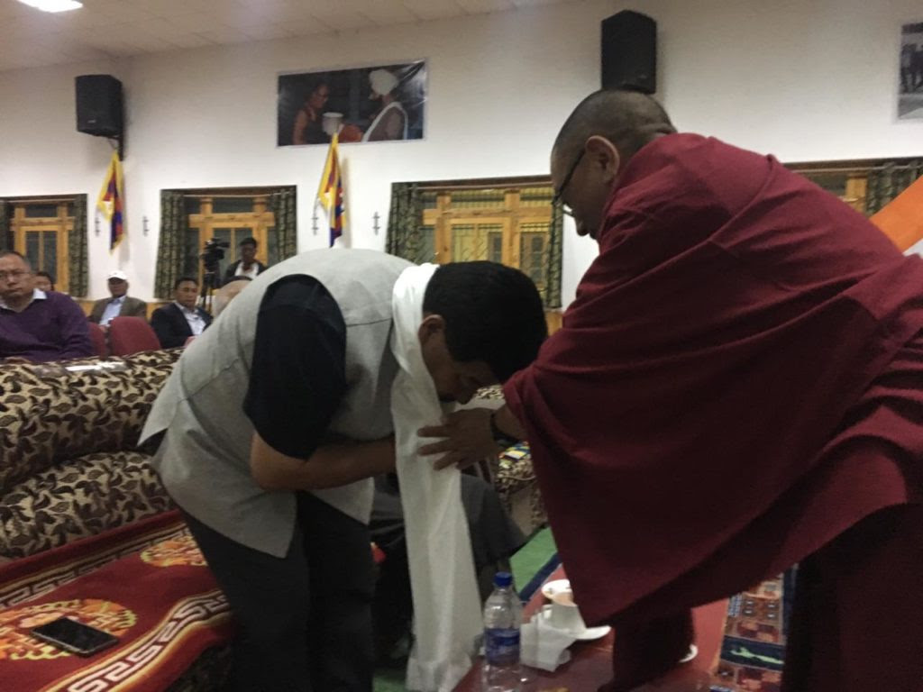 Kalon Karma Yuthok Gelek offering a traditional Tibetan scarf to Hon. Chief Guest Gyal P Wangyal, Chief executive Councilor, Ladakh.