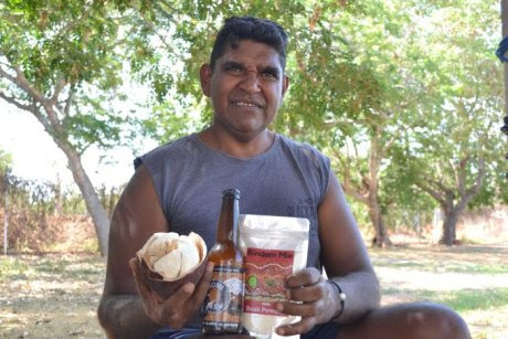 Broome man Robert Dann holding a range of the products he makes using boab nuts