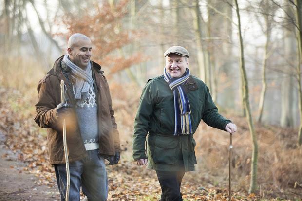 Two older men taking a winter walk together.