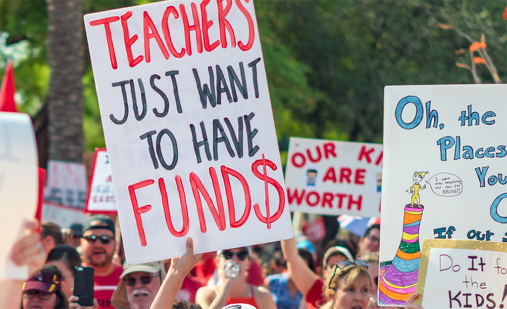 educators protesting to increase funding