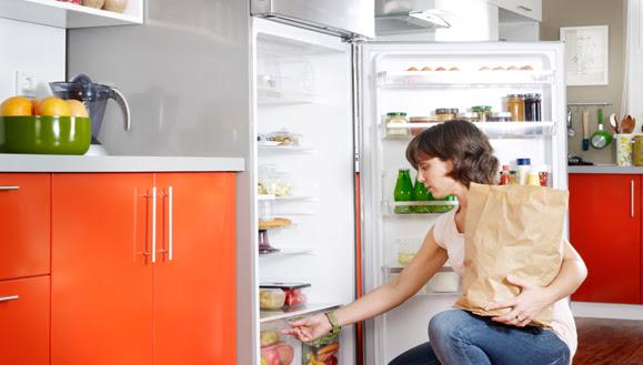 Woman putting away groceries