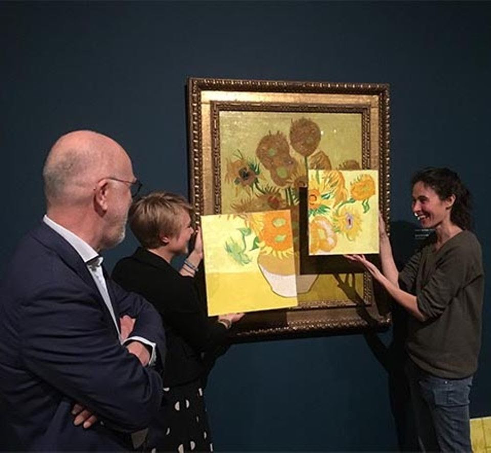 Artist Charlotte Caspers painting her own version to capture the original, brighter appearance of the Amsterdam Sunflowers