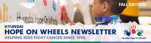 Hyundai Hope on Wheels Newsletter header including picture of boy putting a hand stamp on a Hyundai car.
