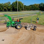 Tractor grading a baseball field at Sammons Park