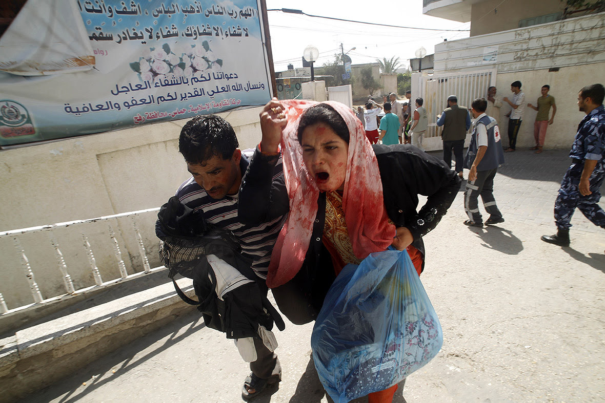 A wounded Palestinian woman arrives at al-Najar hospital in the southern Gaza strip