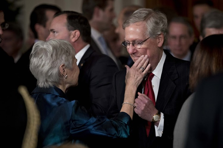 Maureen McCarthy Scalia, the widow of Antonin Scalia, touches the face of Senate Majority Leader Mitch McConnell at the White House last night. (Andrew Harrer/Bloomberg)</p>