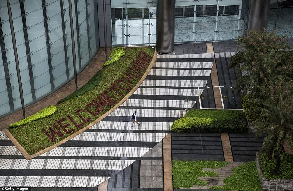 A garden with 'Welcome to Huawei' spelled out in flowers is seen outside one of the office buildings in the complex