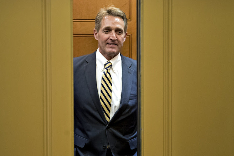 Sen. Jeff Flake stands in an elevator in the basement of the Capitol. (Andrew Harrer/Bloomberg)