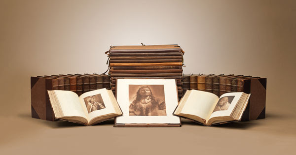 Edward S. Curtis; The North American Indian, Portfolios 1-20; and Vols. 1-20 (displayed above); Stickley Brothers, American Oak Book Cabinet; Estimate $1,500,000-2,500,000