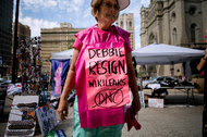 Ann Wright, with the group Code Pink, protested in Philadelphia on Sunday, calling for Debbie Wasserman Schultz to resign as the chairwoman of the Democratic National Committee.