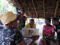 Girl viewing Ebola education flipbook