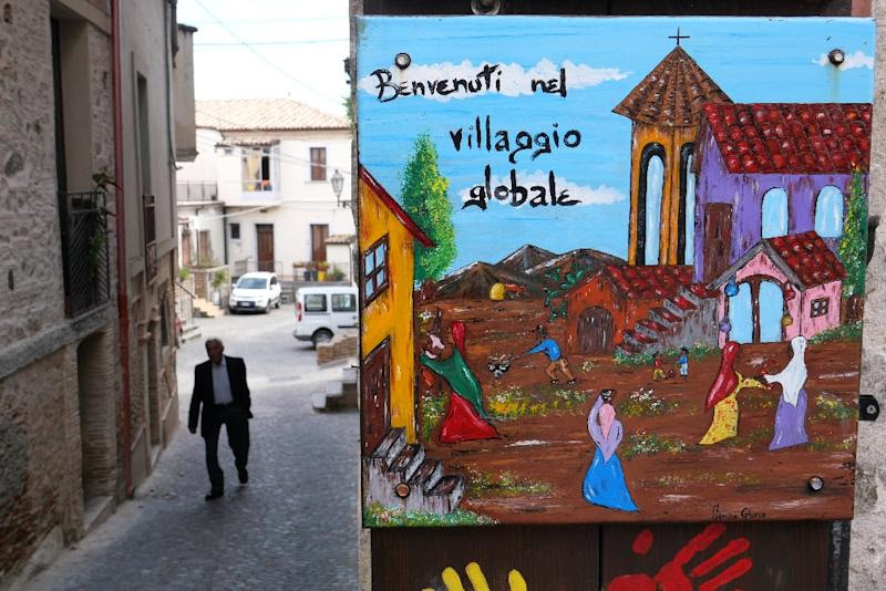 The colourful welcoming signs for refugees are still up, but the town of Riace has swung far-right, against the migrant experiment it once championed