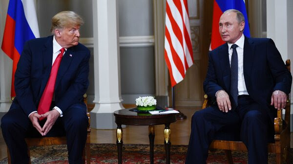 Russian President Vladimir Putin and President Trump meet in Helsinki on Monday. Trump is under pressure to confront Putin about the indictment of 12 Russians accused of conspiring to interfere in the 2016 election.