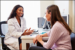 The figure above shows a health care provider counseling a woman.