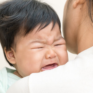 Baby crying experiencing colic