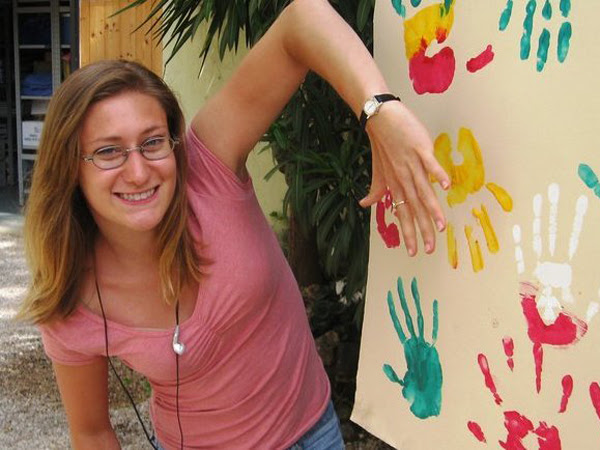 This photo from Amber Long´s Facebook page shows her at a 2010 painting expo in Rome. Philadelphia police said today that a tipster lied about her assailant and that two suspects were released from custody.