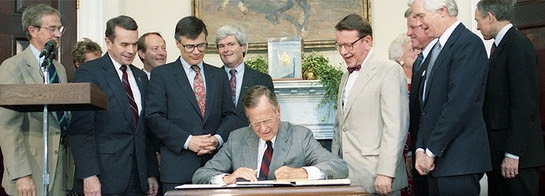 President George H.W. Bush signs the National Literacy Act into law
