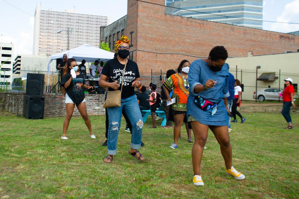 People dancing at the Jackson, Mississippi Juneteenth celebration.
