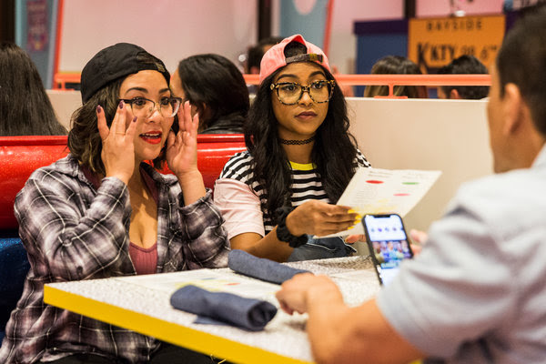 Fiona Trias, left, and Whitnee Turner, both of Orange County, dine at Saved by the Max, a Saved by the Bell-themed pop-up restaurant in West Hollywood.