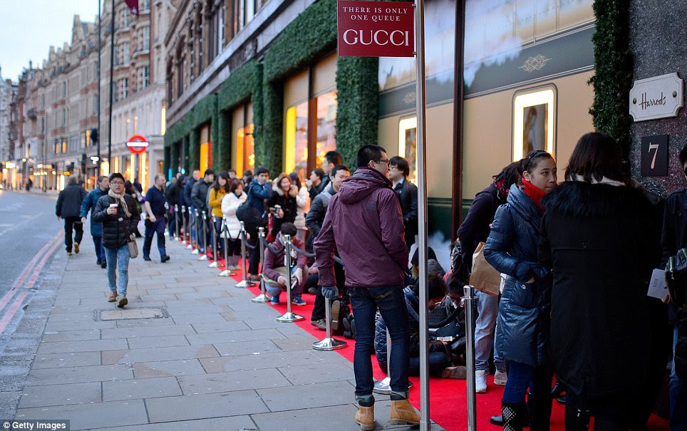 Luxury: Shoppers waited in anticipation of gourmet canapés and a performance by magician Dynamo