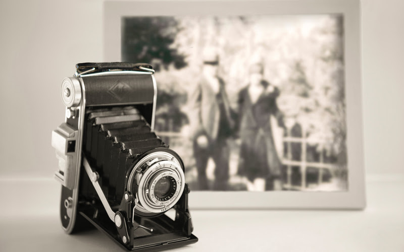 An old camera and a photo.