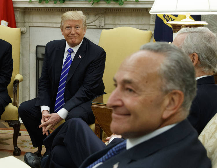 President Trump and Senate Minority Leader Chuck Schumer(D-N.Y.) participate in a meeting in the Oval Office. (Evan Vucci/AP)