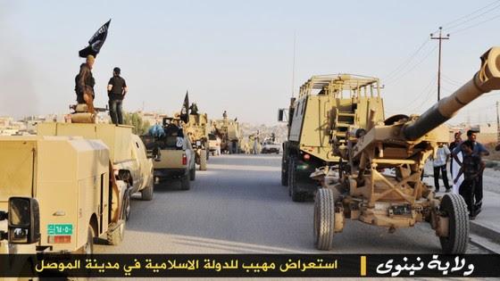 http://www.longwarjournal.org/threat-matrix/assets_c/2014/06/ISIS-Mosul-Parade-3-thumb-560x315-3328.jpg