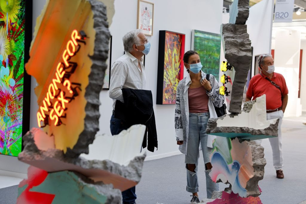People look at artworks during the preview of the 22nd edition of the Art Paris art fair at the Grand Palais in Paris, on September 9, 2020. Photo by Thomas Samson/AFP via Getty Images.