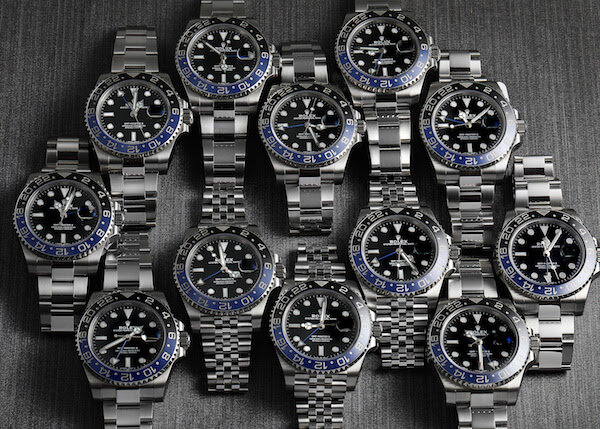 A lineup of Rolex GMT Master II Batman models with Oyster and Jubilee bracelets