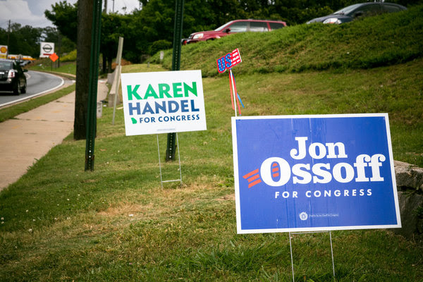Campaign signs for Karen Handel, the Republican candidate, and Jon Ossoff, a Democrat, in Roswell, Ga., ahead of the special election on Tuesday.